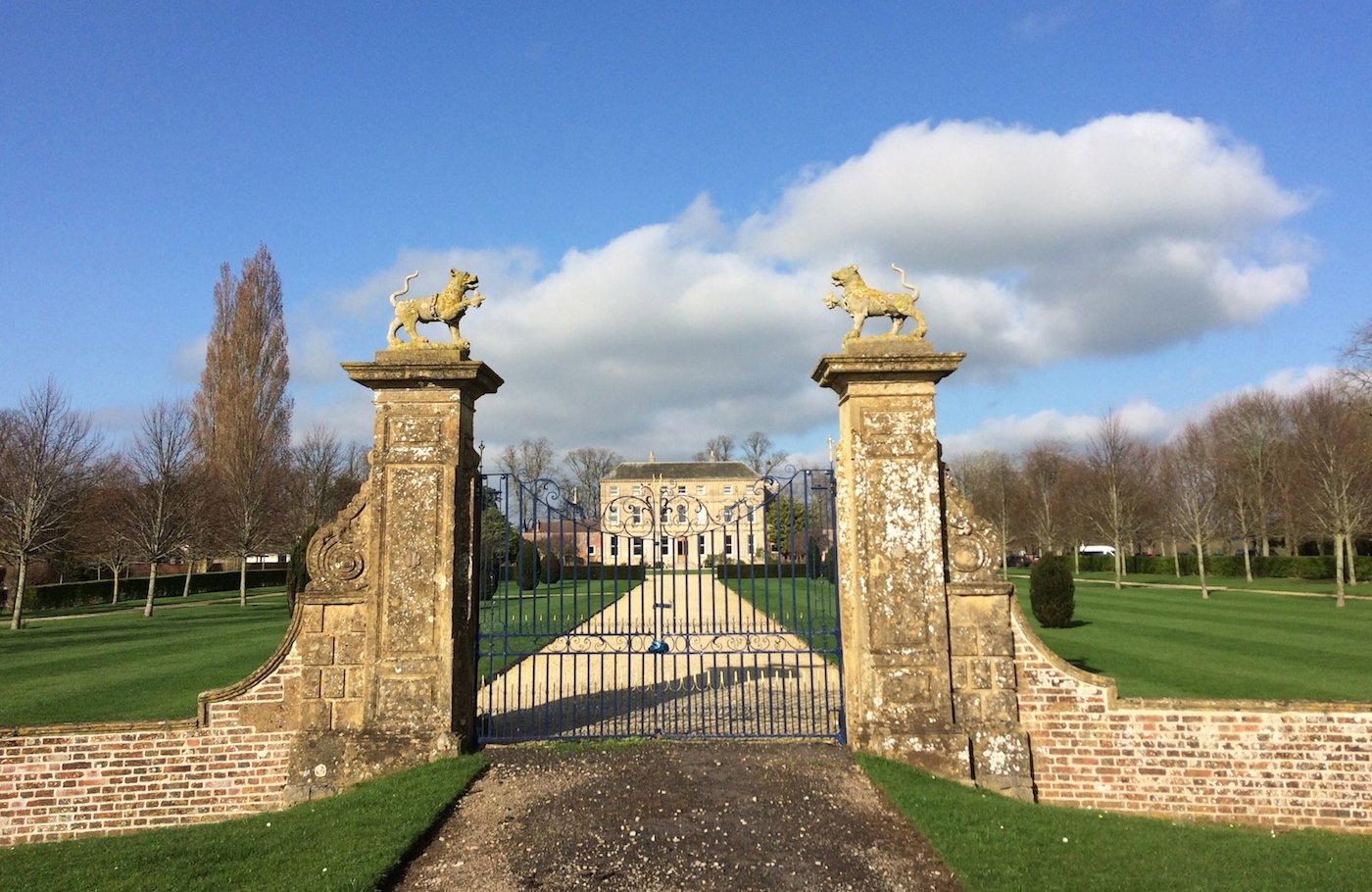 Private school gates with stone lions on top