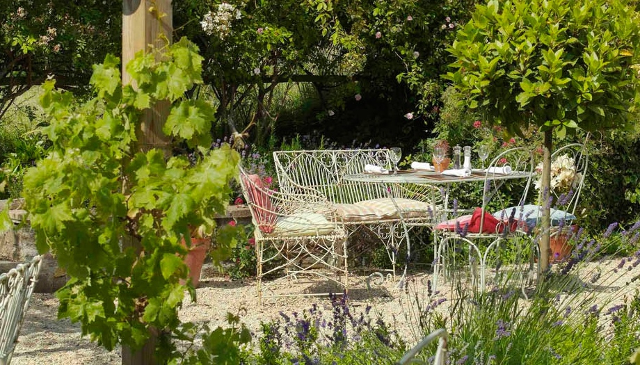 Somerset pub garden with vines and French wire garden tables and chairs