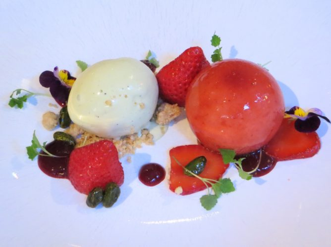 a dish of strawberry mousse with lemon balm and pistachio ice cream