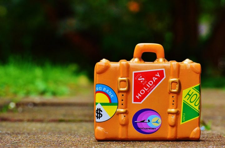 orange lego suitcase with travel labels