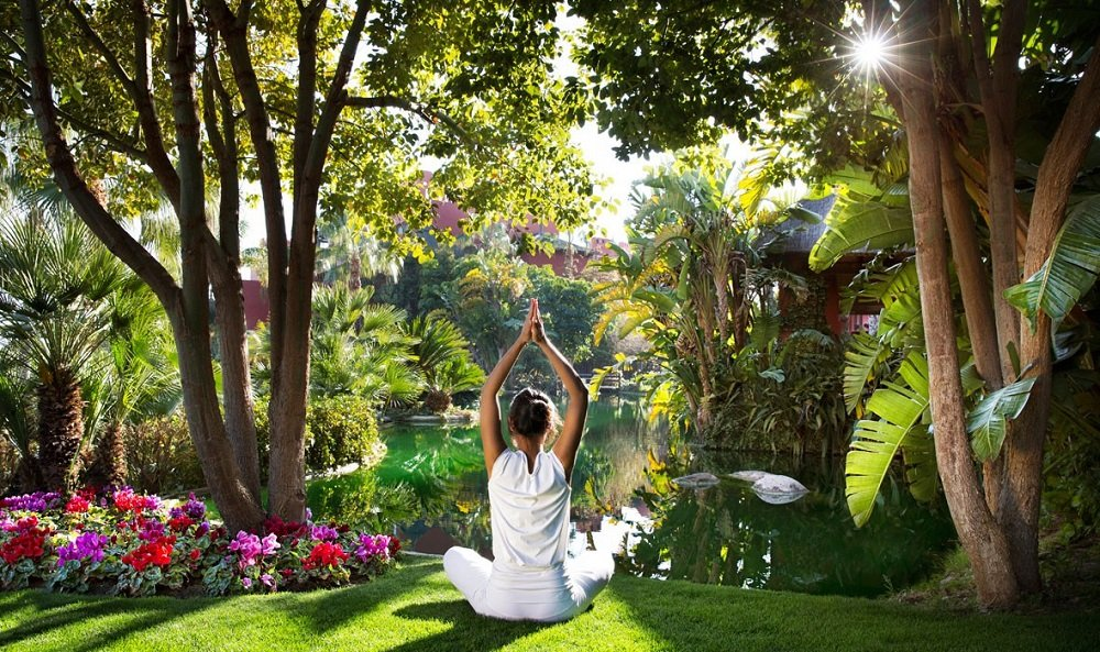 woman in yoga pose exotic gardens hotel