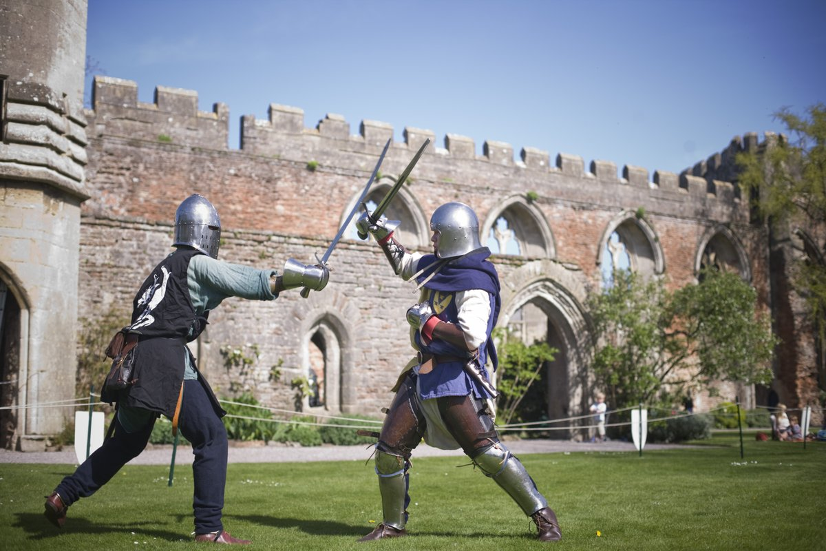 two medieval knights sword fighting