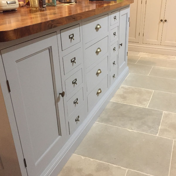 fitted kitchen stone floor wood worksurface