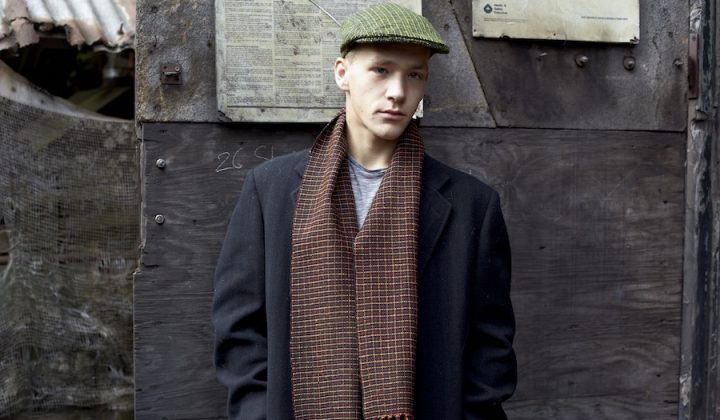 young man with woven flat cap and scarf