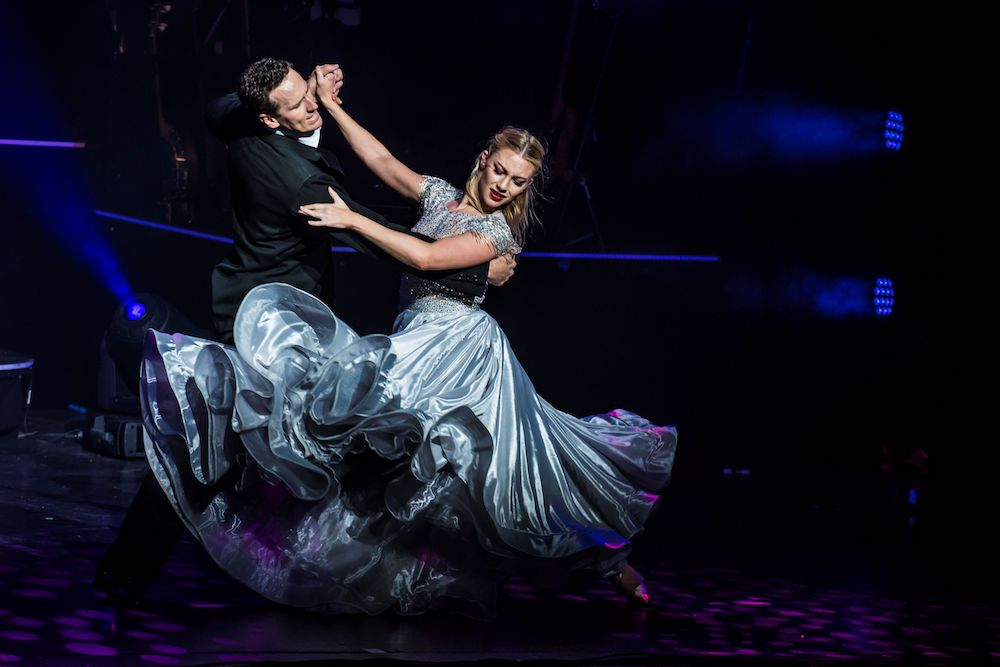 Strictly ballroom couple dancing with flowing skirt