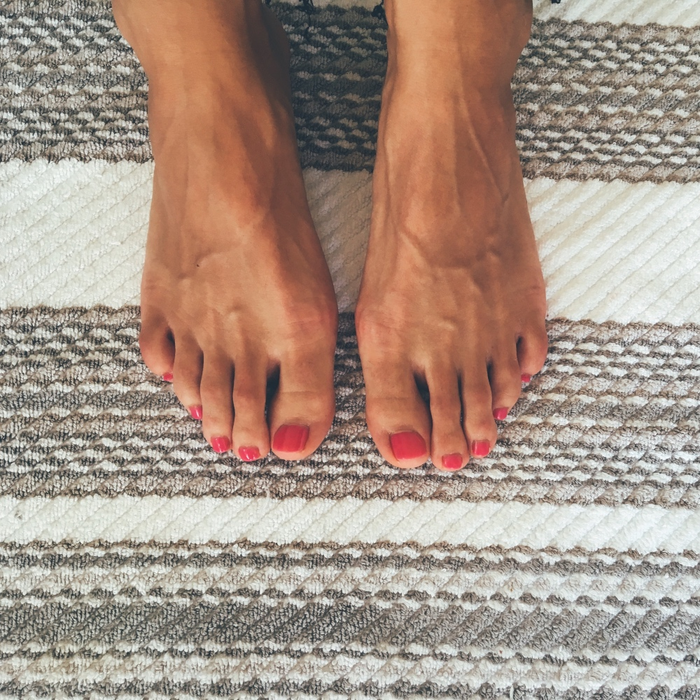 feet red nails polish rug