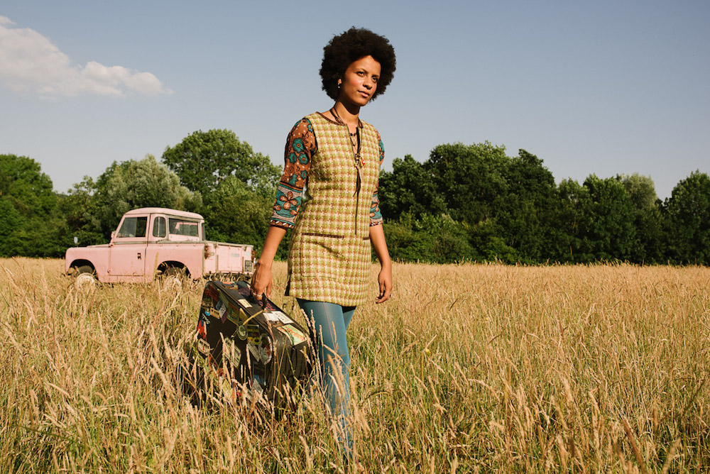 woman landrover grass waistcoat suitcase