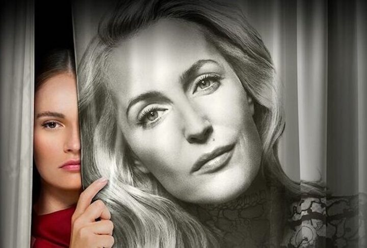 woman Lily James looking out of curtain printed with black and while photo of gillian anderson