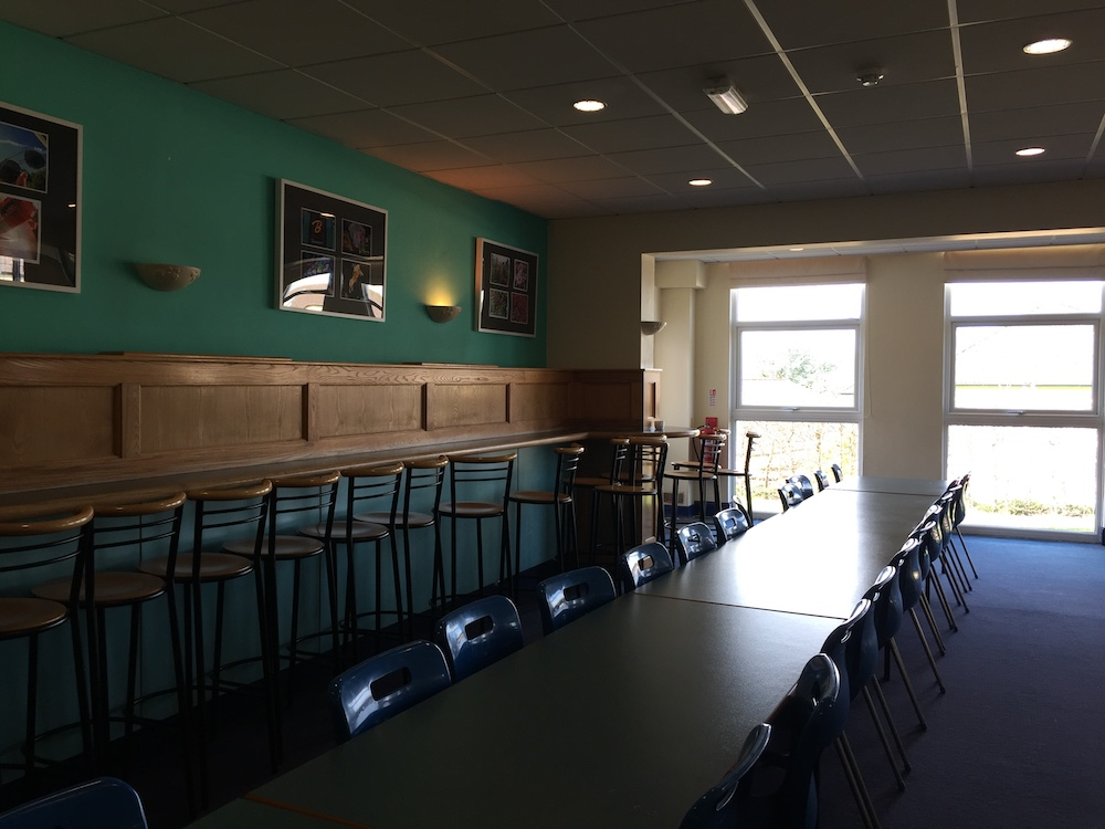 school dining room with tables and high stools