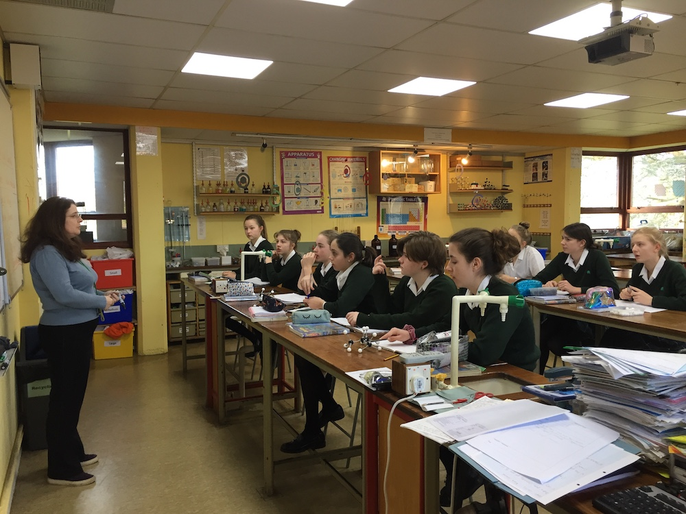 teacher with pupils science lesson