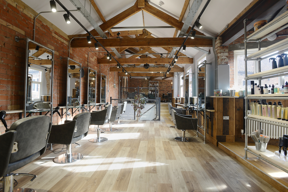 chairs wooden floors beams and mirrors combers inside out hairdressing salon taunton