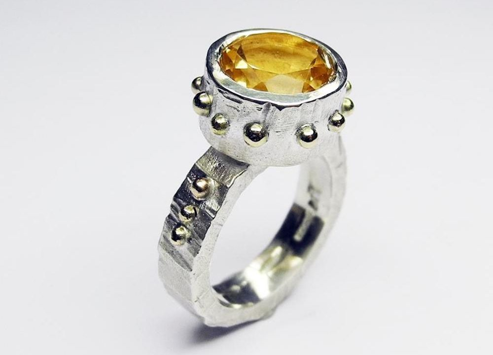 ring with yellow stone