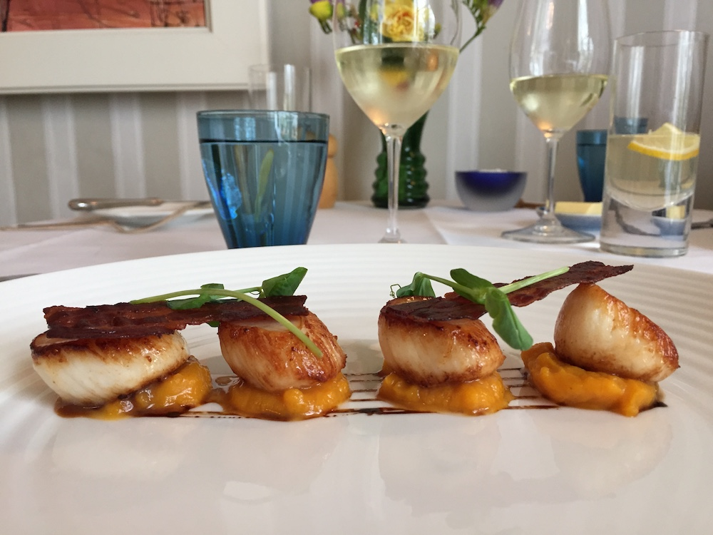 four scallops with bacon