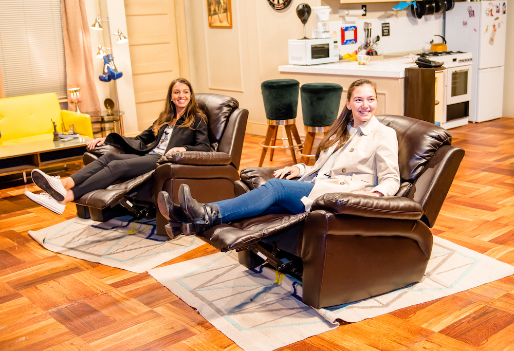 women sitting in reclining armchairs