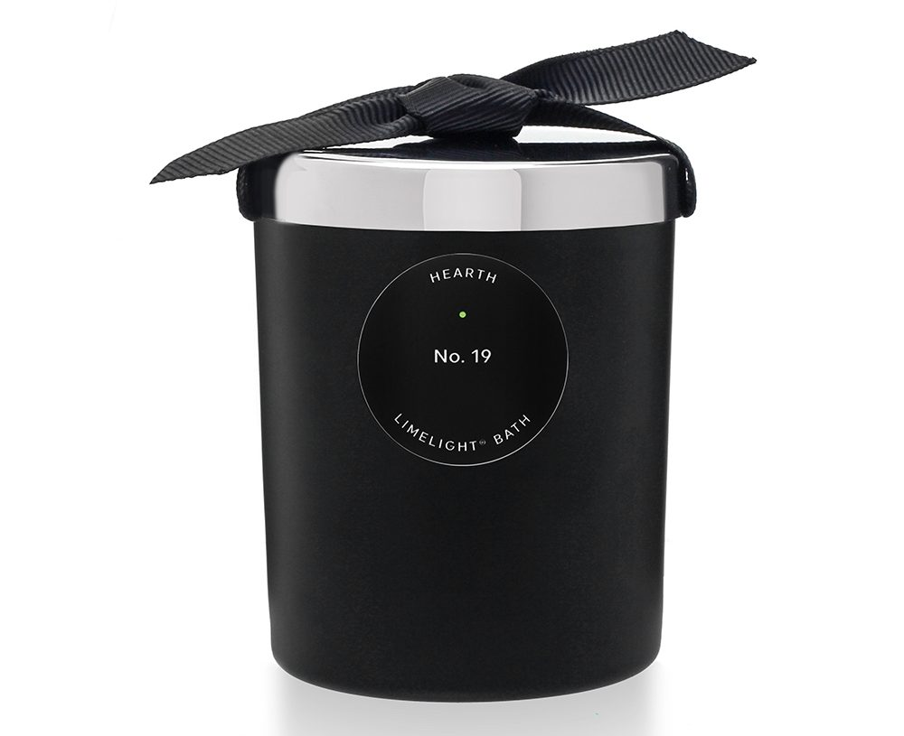 black candle in tumbler with lid