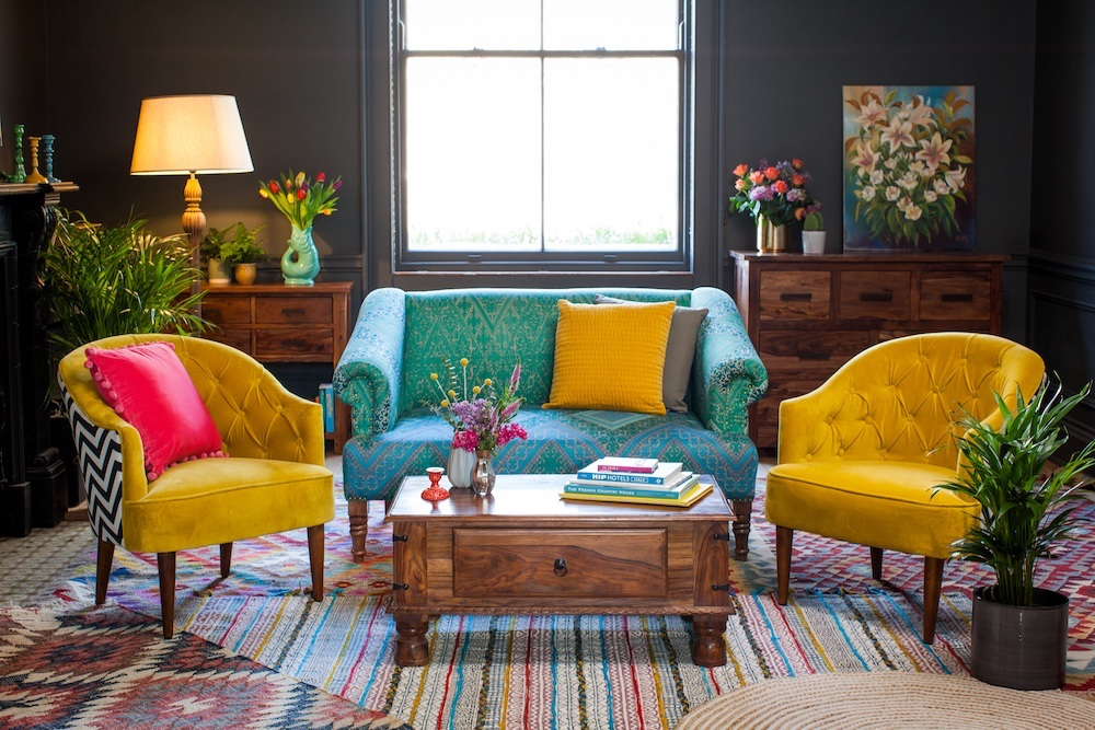 brightly coloured armchairs and sofa