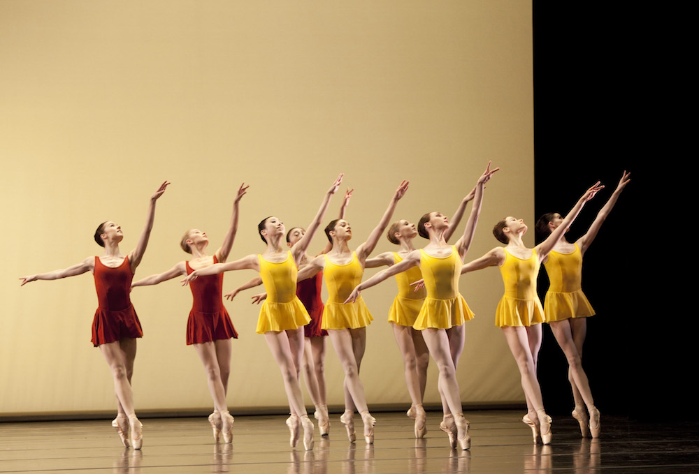 ballet dancers red yellow tunics