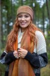 woman with red hair wearing red golden scarf scarves and headwarmer
