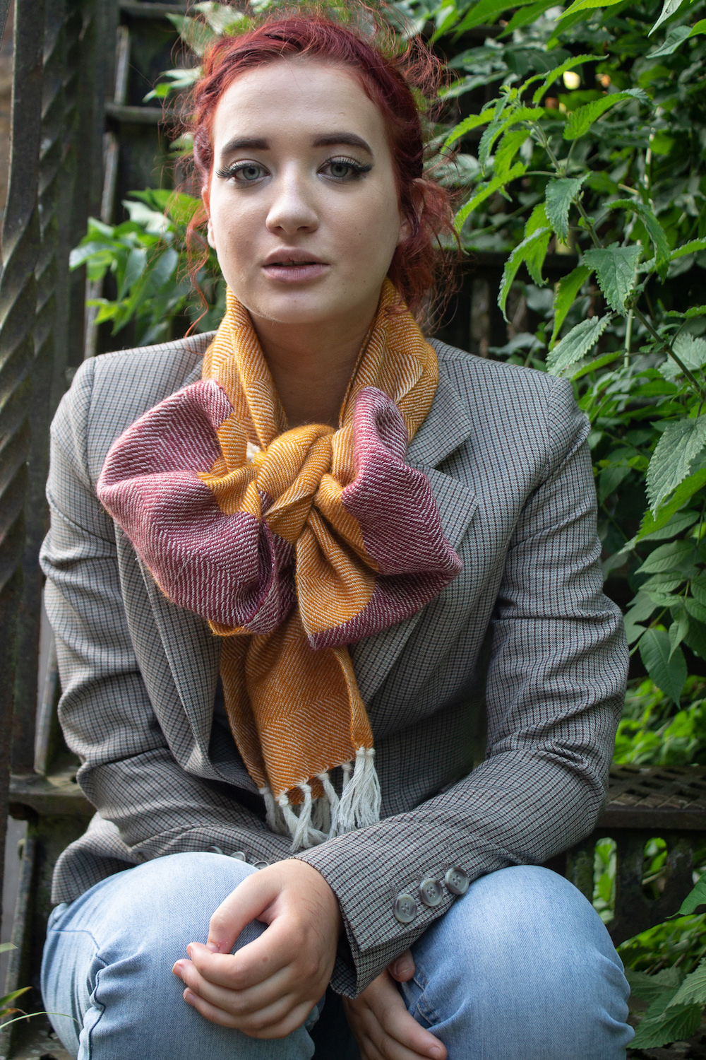 woman wearing red purple scarf tied into a bow