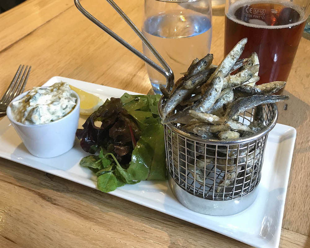 basket of whitebait, salad and lemon