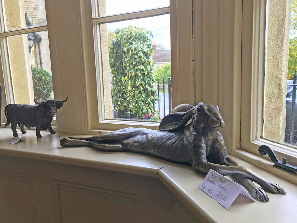 sculpture of a hare on windowsill