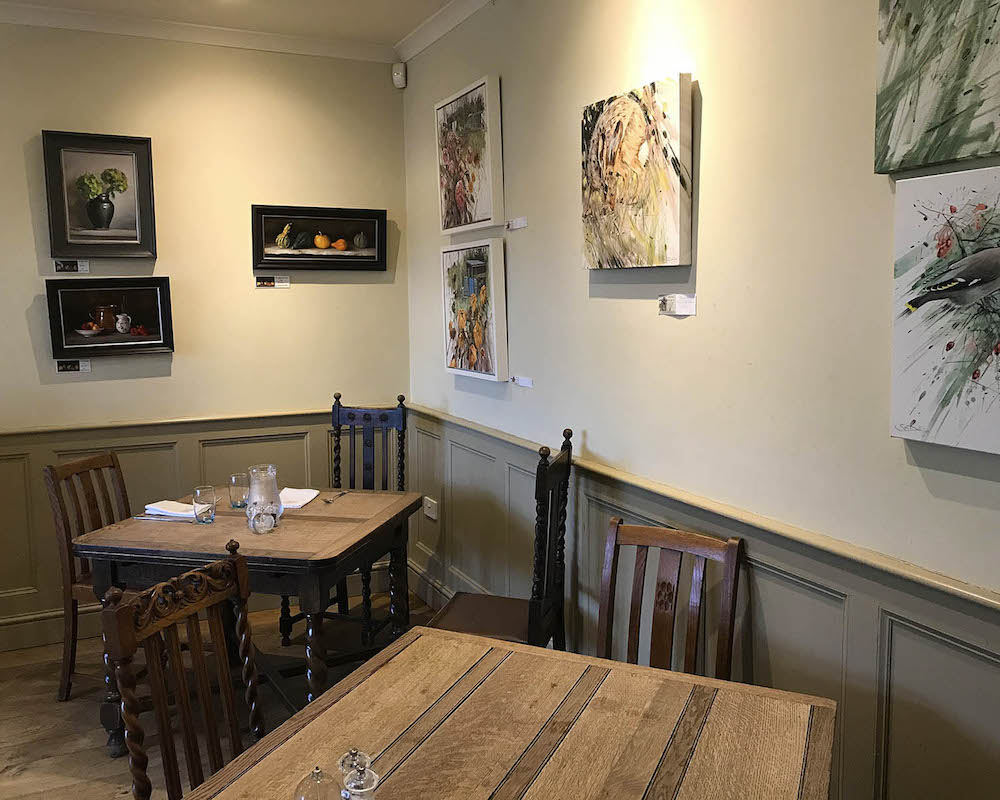 tables, chairs and artwork in rural pubs
