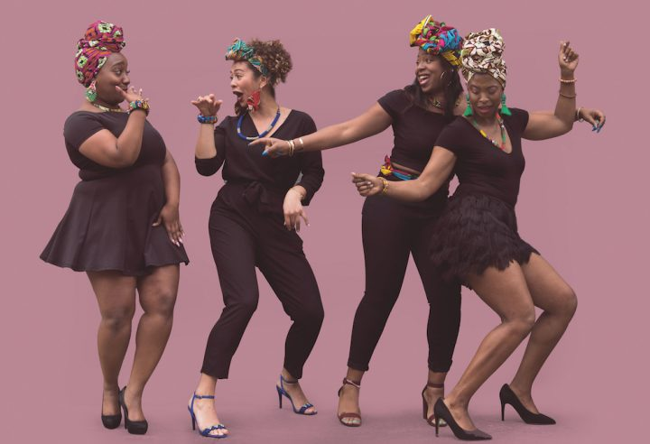 four cool black women dancing