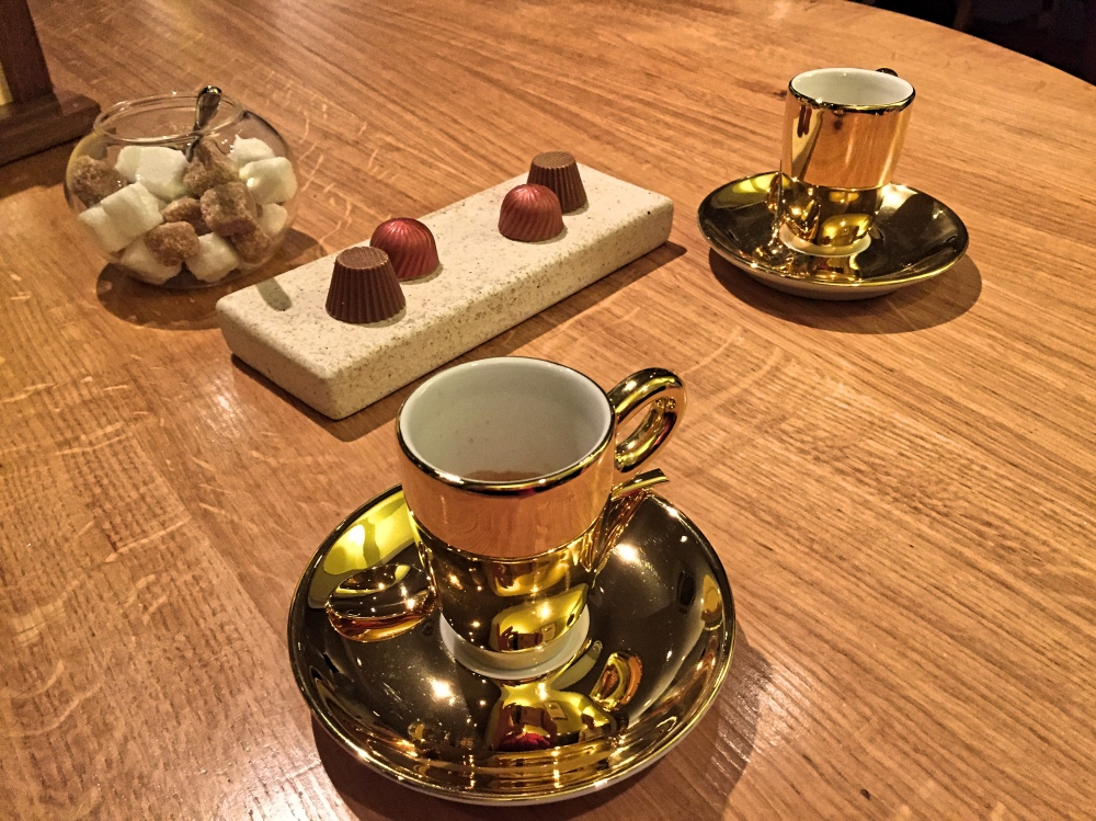 gold cups and petit fours at olive tree restaurant